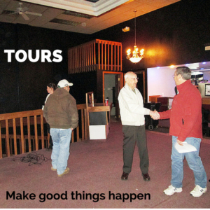 People touring an empty building
